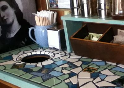 Custom mosaic countertop for Holy Grounds coffee shop, Los Angeles Ca, designed and installed  by tile contractor Ceramic Finishes.