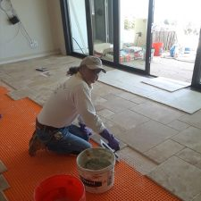 Joey Bermudez, licensed & bonded tile contractor-owner, Ceramic Finishes, Southern California-installing floor tile