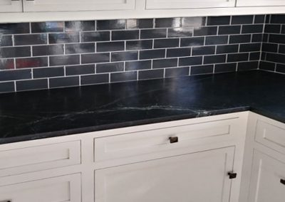 Kitchen backsplash, black subway tile, by Los Angeles tile contractor Ceramic Finishes