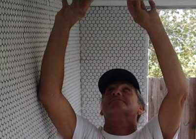 M. Joe Bermudez, tile contractor, Los-Angeles, owner-Ceramic Finishes, checking tile ceiling