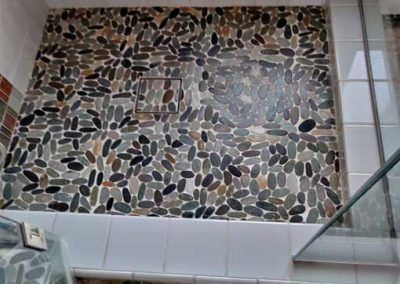 Shower remodel, river rock on shower floor, installation by tile contractor Ceramic Finishes, Alhambra Ca