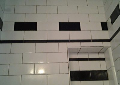 Subway tile shower enclosure before grout by Ceramic Finishes